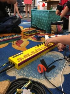 Little hands on a Critter & Guitari Septavox.